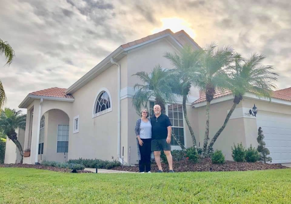 clients standing in front of their new home